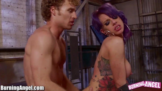 A stripper with purple hair gets fucked until she cums