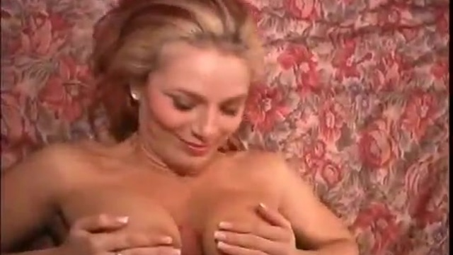 A big-breasted beauty has a threesome with a couple of young men