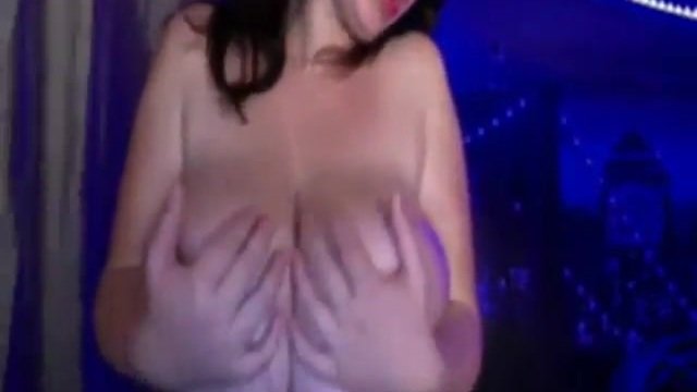 A busty woman in a porn video