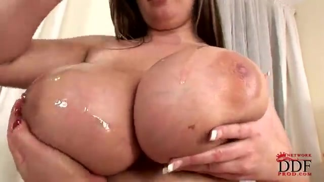Rubbing her enormous tits