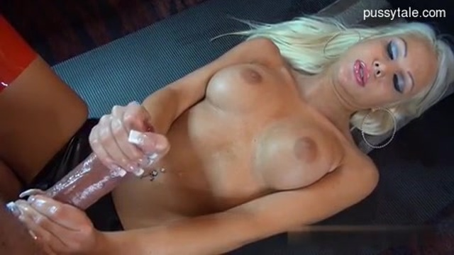 A delicate handjob from a well-endowed blonde