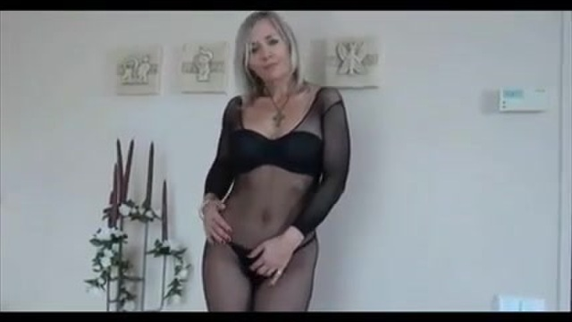 Older woman in lingerie and fishnet stockings