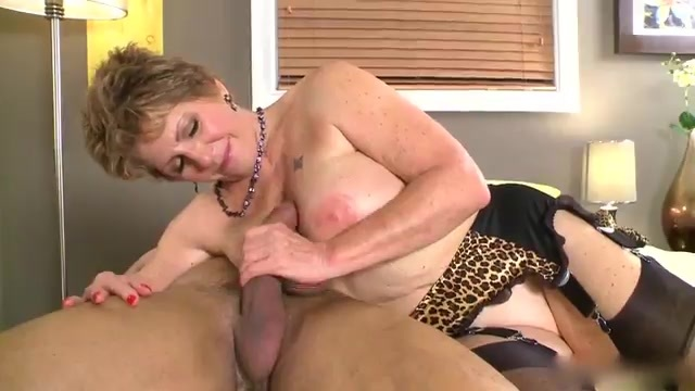 An older woman gets the fucking of her life from a muscled stud