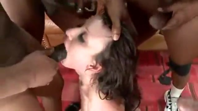 The brunette is imprisoned by black guys in extreme sex