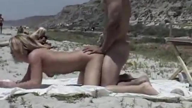 An erotic picnic on an isolated beach