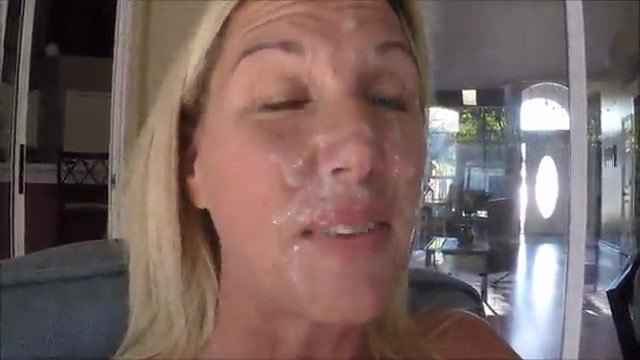 MILF with cum on her face sunbathes