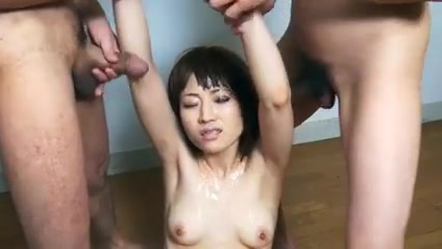 Bukkake for a submissive Japanese woman