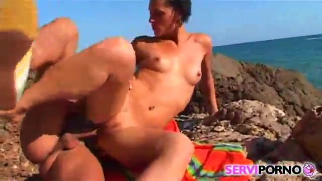A brunette gets a complete fuck at the beach