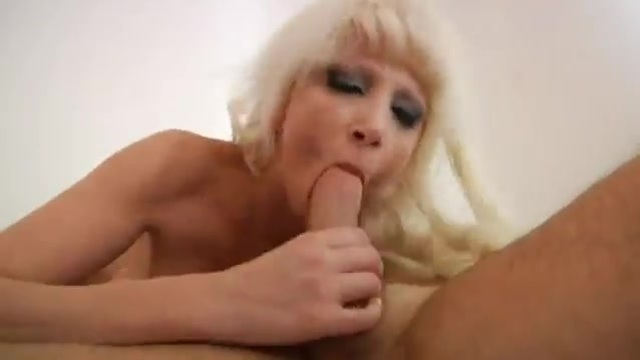A blonde MILF with giant natural tits rides cock