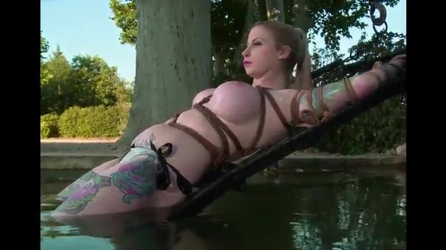 Busty tied up and submerged
