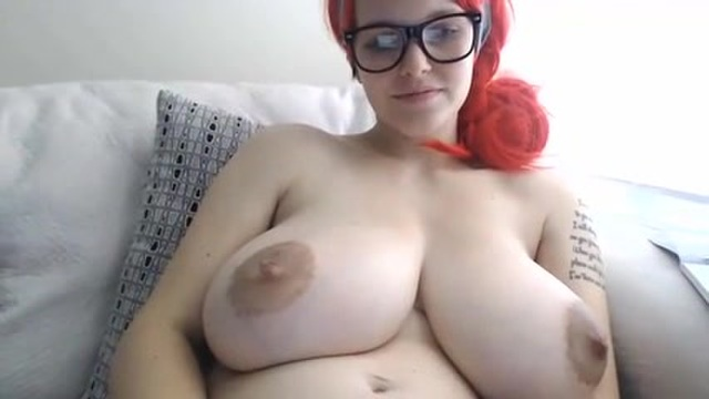 A webcammer with enormous natural tits