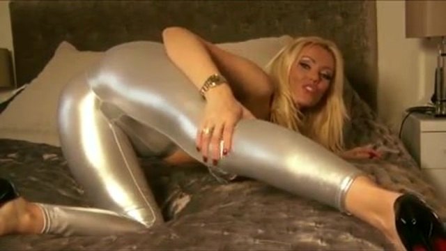 A blonde MILF dressed in grey