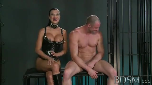 A femdom puts her man in a cage