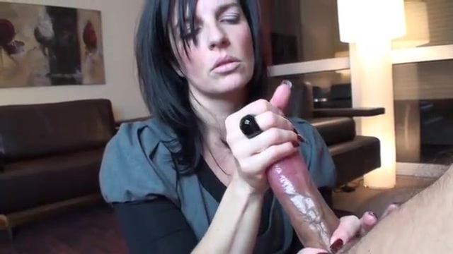 Brunette MILF performing a very slow jerking off