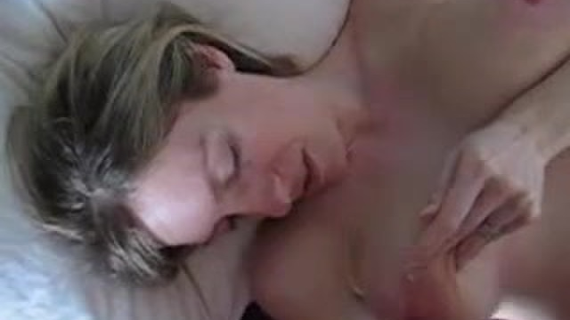 A busty amateur masturbates and sucks