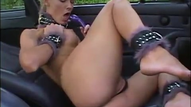 A gorgeous blonde masturbates in the car