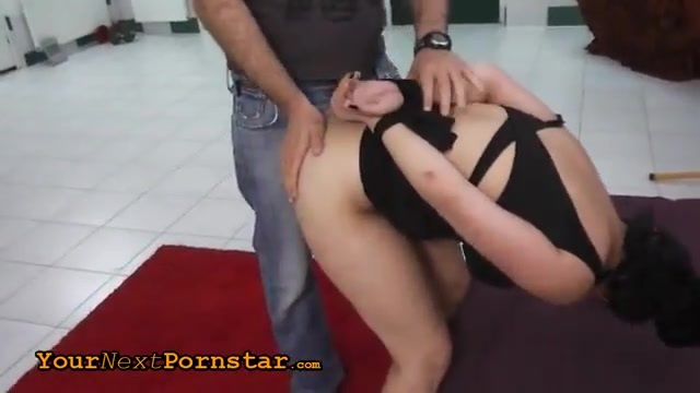 A brunette in a bondage style audition