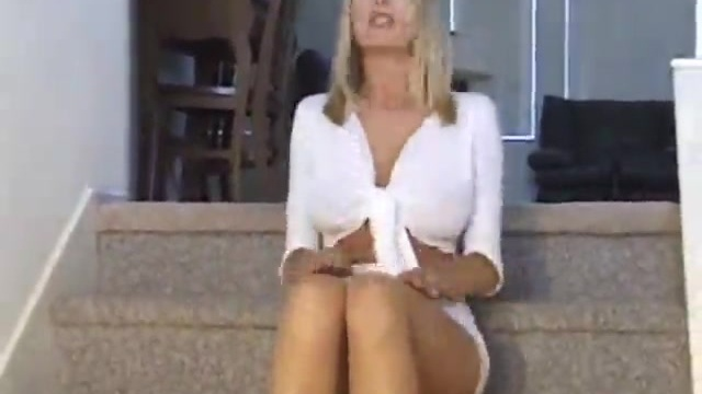 Horny blonde striptease