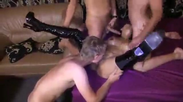 Gangbang with a brunette in leather.
