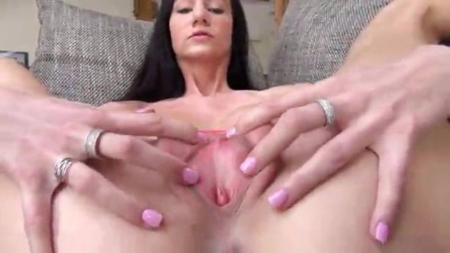 A brunette undresses and opens up her pussy for you