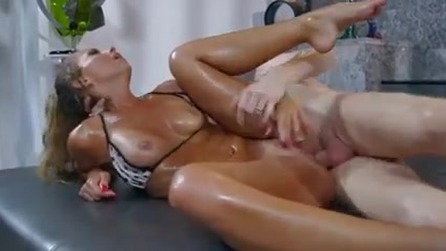 A blonde is all oiled up and fucked to satisfaction