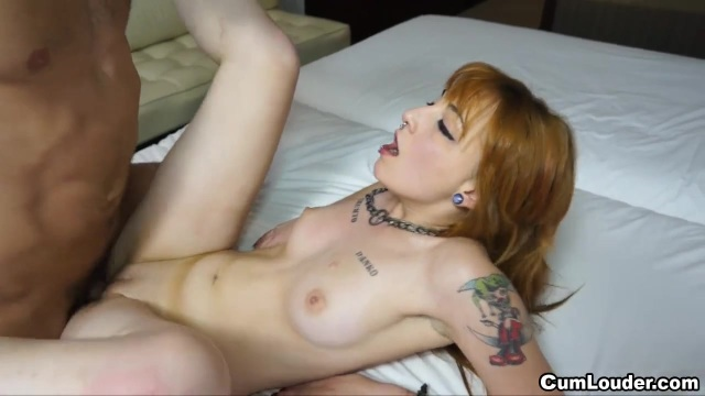 Redhead tattooed girl with piercings banging