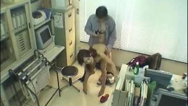 A Japanese girl at work is filmed on a hidden camera