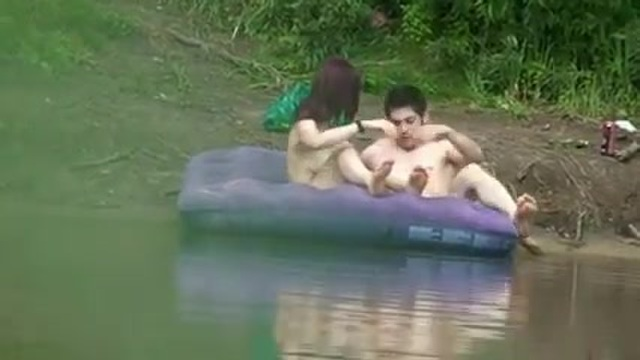 A Japanese couple is caught at the lake