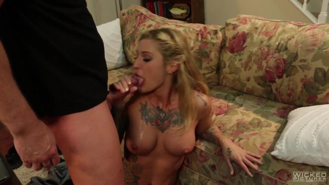 A tattooed young blonde rides cock